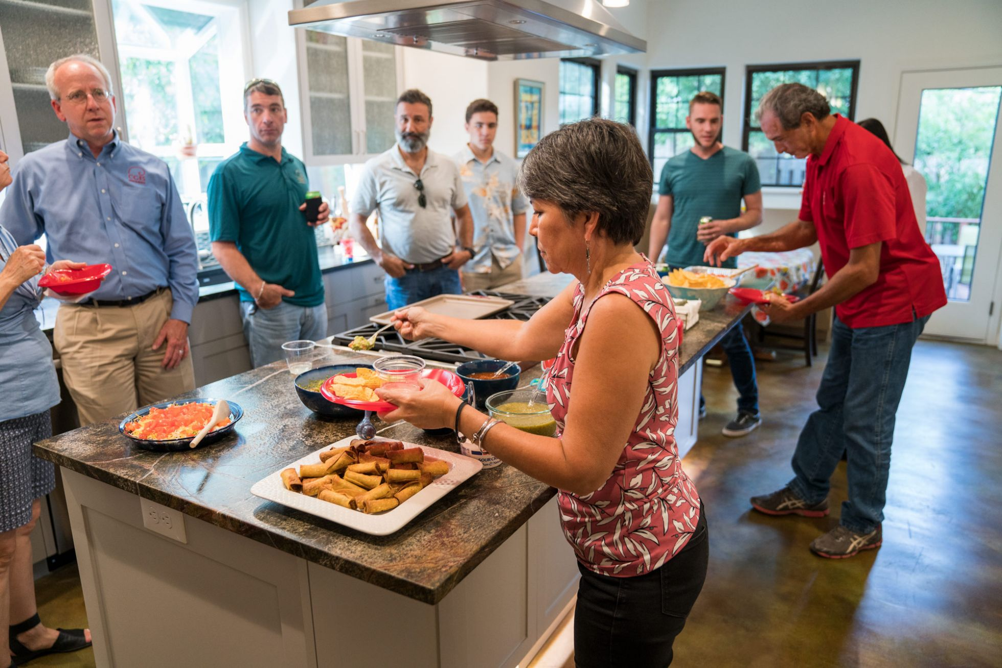 People gathered around kitchen island
