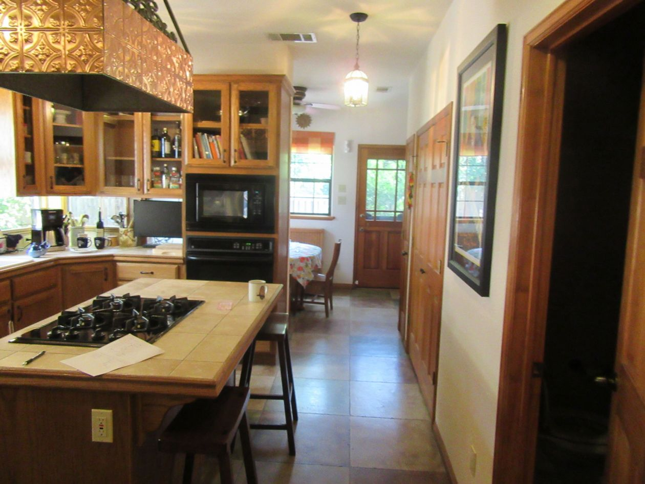 Dark Kitchen with Dining Room View